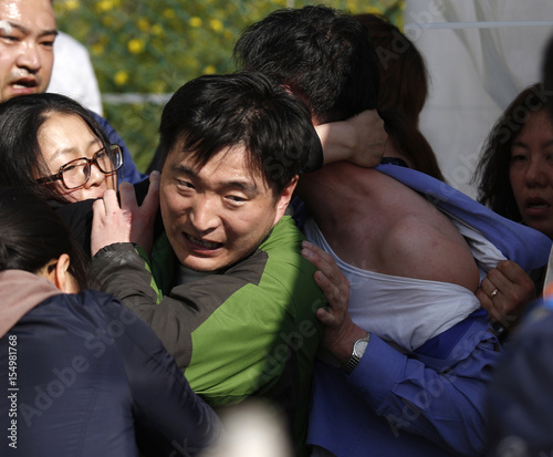 Angry family members of passengers on capsized South Korean ferry