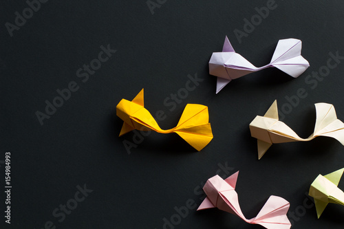 Handmade paper craft origami gold koi carp fishes on black background Canvas Print