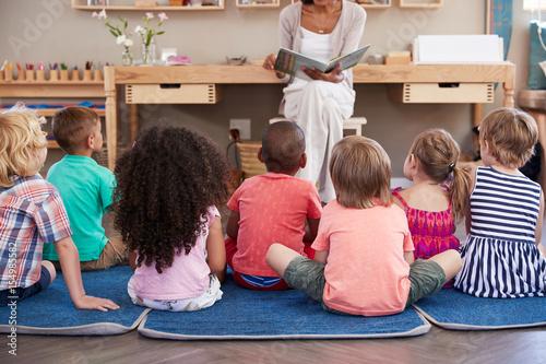 Fotografie, Obraz  Teacher At Montessori School Reading To Children At Story Time