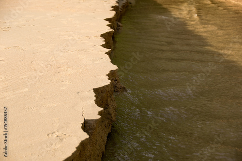 Fotografie, Obraz  Close up Sandbank was eroded with water.