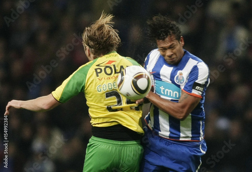 By Miguel Vidal   REUTERS. Porto s Guarin jumps for the ball with Naval s  Godemeche during their Portuguese Premier League soccer match 53698399afa04