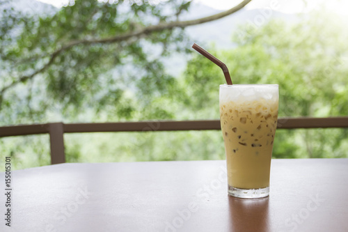 Spoed Foto op Canvas koffiebar Iced coffee on wooden table