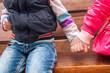 children Girl and boy holding hands