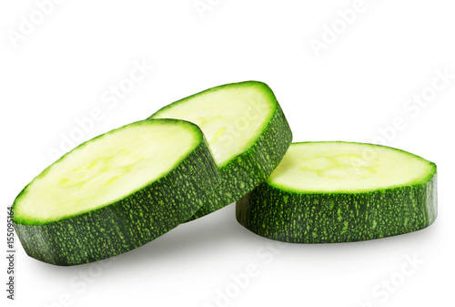 Fresh zucchini slices isolated on a white background.