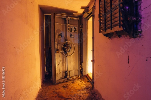 Photo  Opened hermetic door of an abandoned Soviet bomb shelter, an echo of the Cold Wa