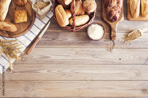 Foto op Aluminium Brood Freshly baked bread on wooden table