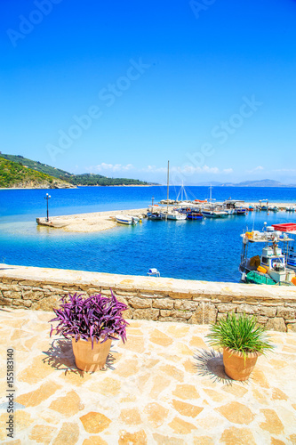Foto auf Gartenposter Stadt am Wasser Boats in port Kouloura in Corfu, Greece
