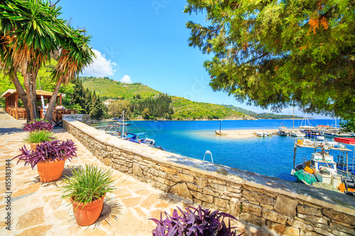 Fotobehang Stad aan het water Boats in port Kouloura in Corfu, Greece