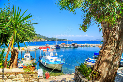 Spoed Foto op Canvas Stad aan het water Boats in port Kouloura in Corfu, Greece