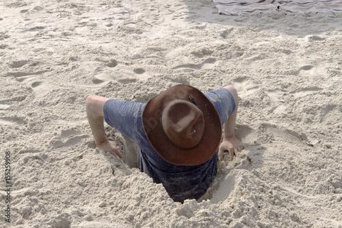 Fotografie, Obraz  Man stuck in the sand