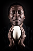 Handsome African Black Man With Ostrich Egg.