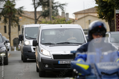 Police escort hearses that transport the remains of victims