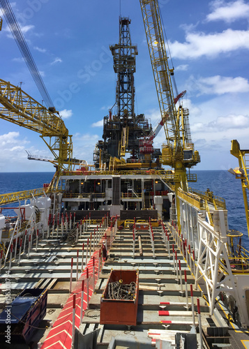 Oil rig tender type is working on oil and gas remote platform to