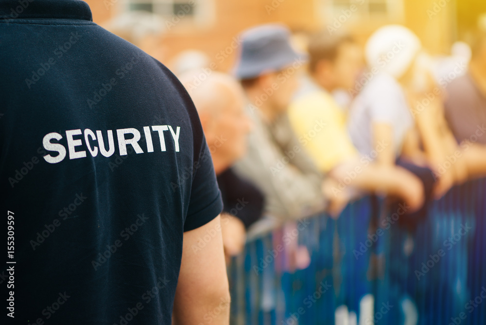 Fototapeta Member of security guard team on public event