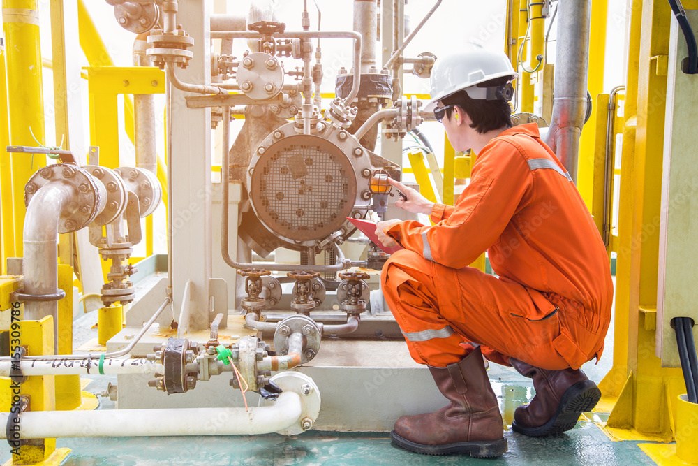 Fototapety, obrazy: Mechanical inspector inspection oil pump centrifugal type. Offshore oil and gas industry maintenance activities.