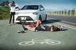 Unconscious male cyclist lying on road after road accident, Selective focus