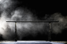 Gymnastic Parallel Bars. Isolated On Black Background With Fog,