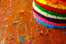 Multi Colored Rainbow Sponge Cake Surrounded With Colorful Crumbs
