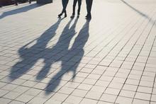 Shadows Of Three Friends On Pa...