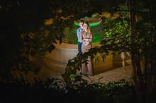 Romantic Couple In The Tropical Jungle Near The Fountain