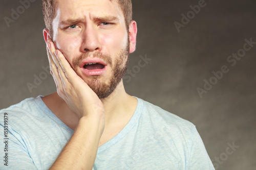 Fotografia  Man suffering from toothache tooth pain.