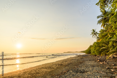 Deurstickers Strand Sunset at paradise beach in Uvita, Costa Rica - beautiful beaches and tropical forest at pacific coast of Costa Rica - travel destination in central america