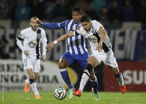 By Miguel Vidal   REUTERS. Guimaraes  Marco Matias fights for the ball with  Porto s Alex Sandro during their Portuguese Premier 80b16d50497b0