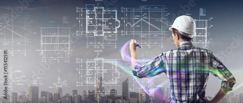 Engineer woman draw layout
