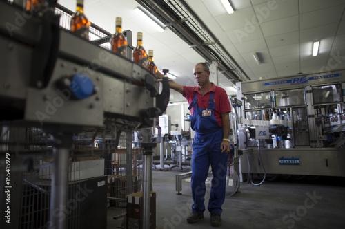 Worker Alexander Hernandez 38 Checks Rum Bottles At A Production