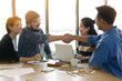 Business peoples shaking hands for business agreement in office