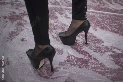 33667af27c9b A woman sports high heels along a rain soaked red carpet ahead of the 86th  Academy Awards in Hollywood
