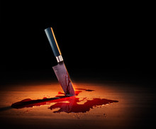 Dramatic Lit Image Of A Bloody Crime Scene With A Knife On The Floor