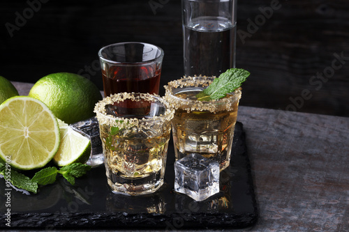 Canvas Prints Bar Selection of alcoholic drinks on rustic stone plate