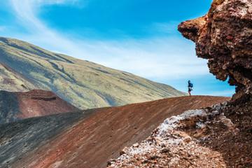 Tourist stood on Mount Etna volcano