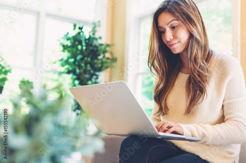 Fotografie, Obraz  Happy young latina woman using her laptop at home