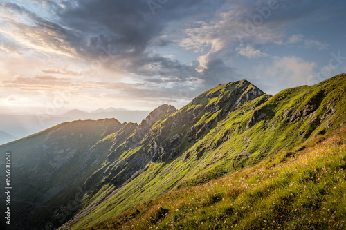 Foto auf Gartenposter Gebirge Beautiful alpine mountain landscape with dark clouds in the evening light