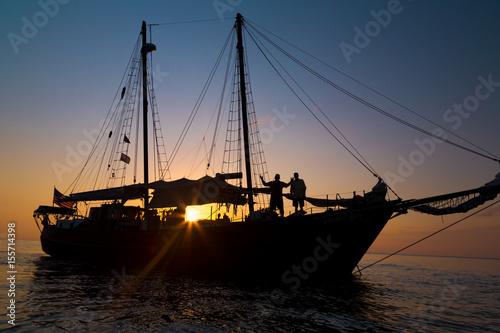 Schooner Pirate Ship in Sunset - Buy this stock photo and explore