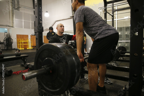 WWE wrestler Bin Wang works with trainer Sean Hayes at the