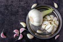 Fresh Garlic On A Dark Background.