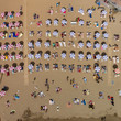 Aerial view of beach with beach umbrellas during summer