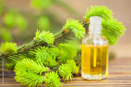 Fotografie, Obraz  Essence of pine on table in beautiful glass jar