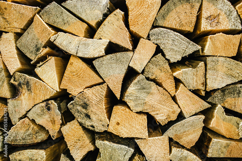 In de dag Brandhout textuur Natural wooden background, closeup of chopped firewood.