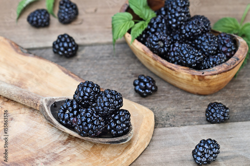 Valokuva  Blackberries in Wooden Spoon and Bowl