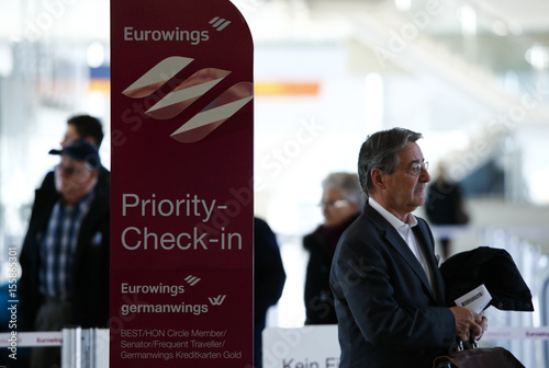 Travellers Check In To Board An Airbus A330 Belonging To Lufthansas