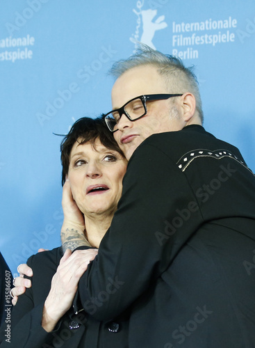 Director Cote embraces actress Robitaille during a photocall to