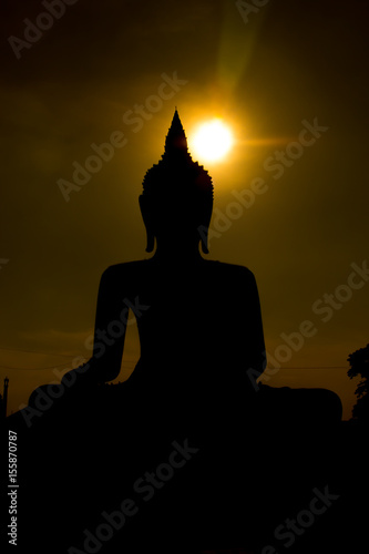 Poster Temple silhouette Big Buddha on sunset background in Phichit, Thailand