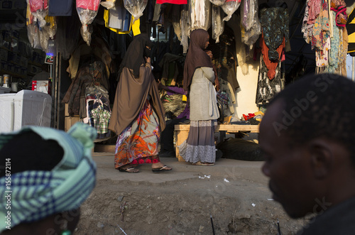 Women walk past a clothes shop in the market of Eastleigh, a suburb