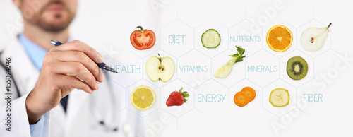 Fototapeta healthy food concept, Hand of nutritionist doctor pointing fruit with pen obraz