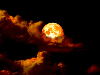 super blood moon in gold sky in night