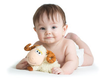 Baby Boy Lying On Tummy With Lamb Toy Isolated